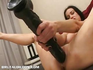 brunette cumming all over a giant brutal sex toy