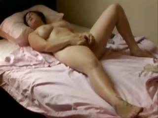 my sweet mum fisting on her bed. hidden cam
