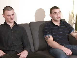 two fine looking gay guys undress on the armchair