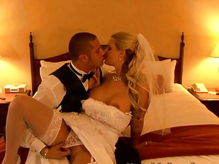 blond bride into colorless gown undresses and