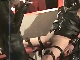 woman with big bossom burns balls of tied slave