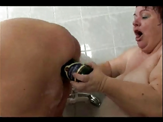 giant older  homosexual women obtaining a bath