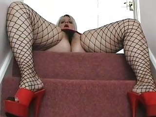 fat uk woman lady posing into dark fishnets