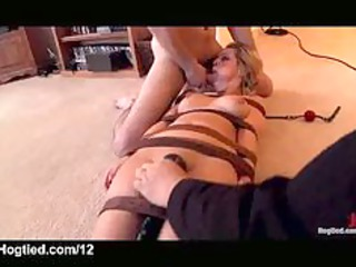 strapped busty blonde oral pierced on the floor