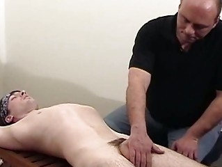 daddy gives massage to beautiful son