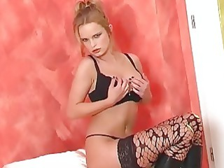 girl in black galoshes and pantyhose wipes her