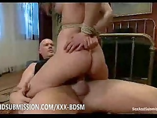 bondage redhaired chick gives dual penetration