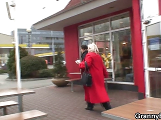 giant grandma is picked up into cafe