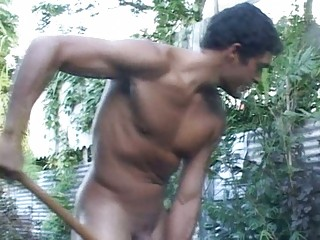 muscular gay fellow works inside the garden nude