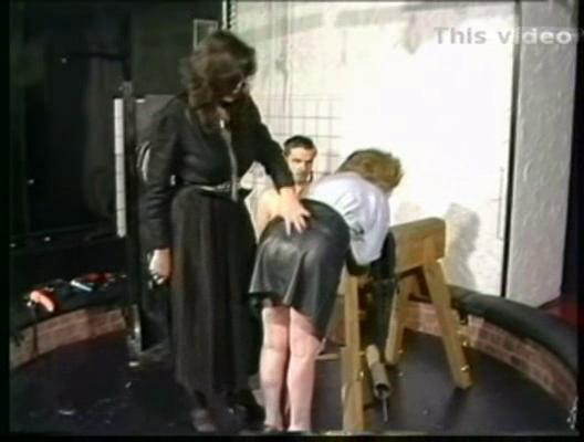 slave into leather dress is bend over by slutty
